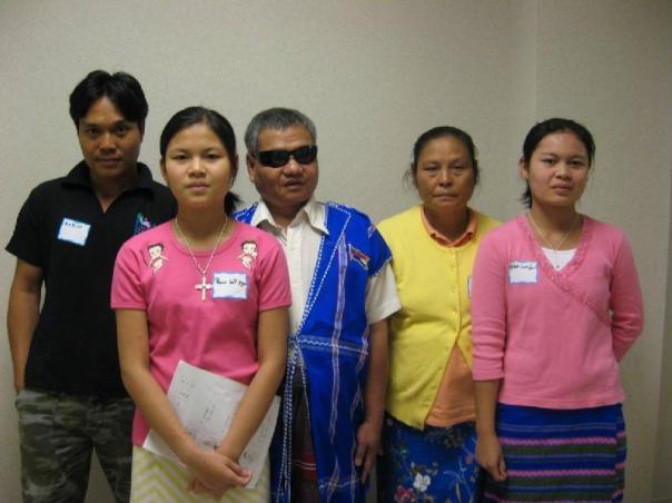 Moo Whaa (in yellow) & her family