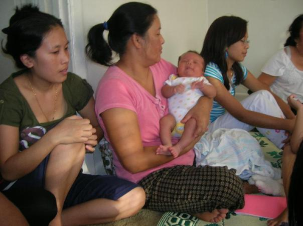 Cer Thlia Tial (mother) beside NuNu holding the Baby